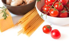 Pasta, tomatoes, cheese and  mushrooms Stock Image