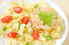 Pasta with tomatoes and chicken cutlet Royalty Free Stock Images