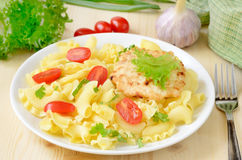 Pasta with tomatoes and chicken cutlet Stock Image