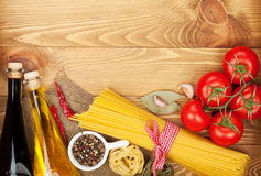 Pasta, tomatoes, condiments and spices Stock Photos