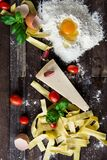 Pasta Tomatoes and Flour With Egg Shells on Table Stock Photography