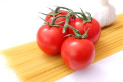 Pasta with tomatoes and garlic Stock Images