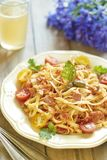 Pasta with tomatoes, ham, capers and cheese Royalty Free Stock Photography