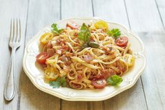 Pasta with tomatoes, ham, capers and cheese Stock Photography