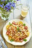 Pasta with tomatoes, ham and cheese. Pasta with tomatoes, ham, capers and cheese royalty free stock photo