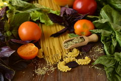 Pasta, tomatoes with herbs Stock Images