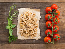 Pasta, tomatoes and herbs Royalty Free Stock Photo