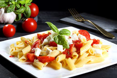 pasta with tomatoes and mozzarella cheese Stock Image