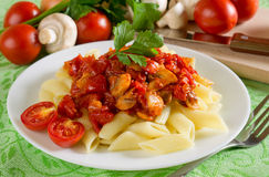Pasta with tomatoes. And mushrooms Royalty Free Stock Photos