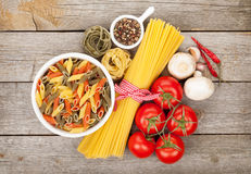 Pasta, tomatoes, mushrooms and spices Royalty Free Stock Photography