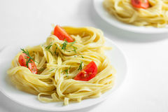 Pasta with tomatoes and olive oil. Cooked pasta with tomatoes and olive oil Stock Photo