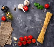 Pasta, tomatoes, olive oil and vinegar Royalty Free Stock Images