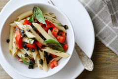 Pasta with tomatoes and olive Stock Images