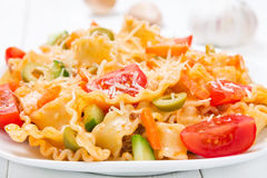 Pasta with tomatoes and olives Stock Photo