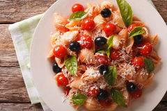 Pasta with tomatoes, olives and parmesan cheese close-up. Horizo Stock Photography