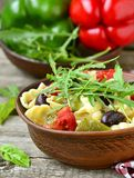 Pasta with tomatoes, pepper and olives Stock Images