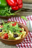 Pasta with tomatoes, pepper and olives Stock Photo