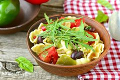 Pasta with tomatoes, pepper and olives Royalty Free Stock Photos