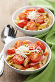 Pasta with tomatoes and salami Royalty Free Stock Image