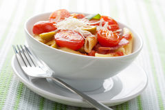 Pasta with tomatoes and salami Stock Photography