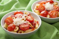 Pasta with tomatoes and salami Stock Images