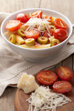 Pasta with tomatoes and salami Royalty Free Stock Photos