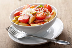 Pasta with tomatoes and salami Royalty Free Stock Images
