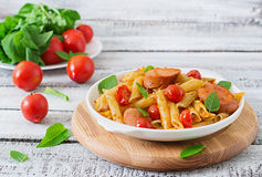 Pasta with tomatoes and sausage. Royalty Free Stock Image