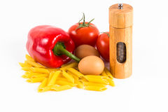 Pasta, tomatoes and spices on a white background Royalty Free Stock Image