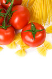 Pasta and tomatoes on the white Stock Images