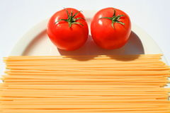 Pasta and Tomatos Stock Photo
