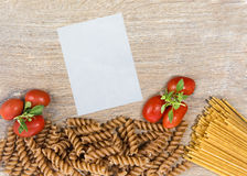 Pasta with tomatos. And Basil On wood background Royalty Free Stock Photography