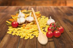 Pasta, Tomatos and Garlic Stock Images