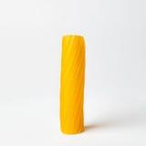 Pasta tortiglione. Close-up of a single pasta(Italian tortiglione)  on white background Royalty Free Stock Image