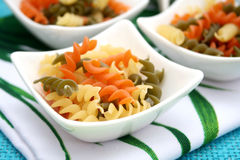 Pasta tricolor. Some pasta in orange, green and yellow royalty free stock photos