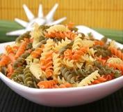 Pasta tricolore. Some uncooked italian pasta tricolore in a bowl Stock Image