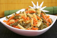 Pasta tricolore. Some uncooked italian pasta tricolore in a bowl stock images