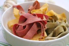 Pasta tricolore. Some colourful pasta in a bowl Stock Image