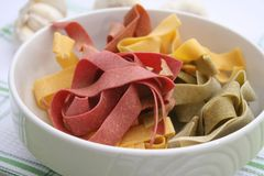 Pasta tricolore. Some colourful pasta in a bowl royalty free stock image