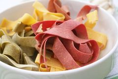 Pasta tricolore. Some colourful italian pasta in a bowl Royalty Free Stock Photography