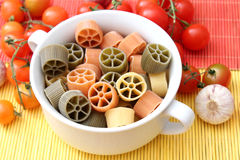 Pasta tricolore. Some fresh pasta tricolore in green, yellow and orange Stock Photo