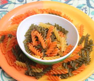Pasta tricolore. Some italian noodles in green, orange and yellow royalty free stock image