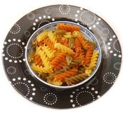 Pasta tricolore. Some italian pasta tricolore in yellow, green and orange Royalty Free Stock Images