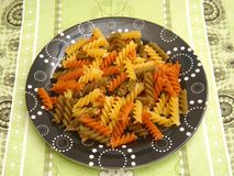 Pasta tricolore. Some italian pasta tricolore in yellow, green and orange Stock Image