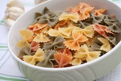 Pasta tricolore. Some uncooked colourful pasta in a bowl Royalty Free Stock Photography