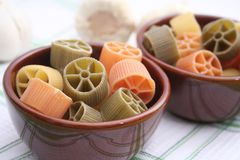 Pasta tricolore. Some uncooked colourful pasta in a bowl Royalty Free Stock Photos
