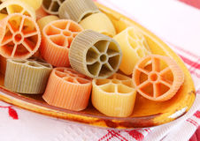 Pasta tricolore. Some pasta tricolore in yellow, green and red royalty free stock photo