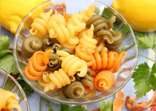 Pasta tricolore. Some pasta tricolore in yellow, green and red royalty free stock image