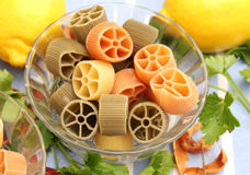 Pasta tricolore. Some pasta tricolore in yellow, green and red stock image