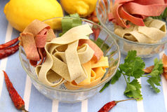 Pasta tricolore. Some pasta tricolore in yellow, green and red stock photo